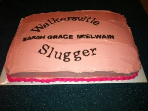 The hot pink frosting on the side of the cake.