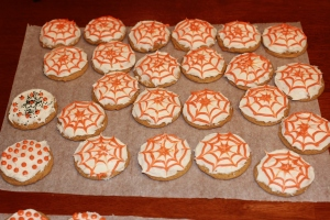 Vanilla/orange icing spider web cookies