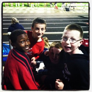 Ty, Nick, and another friend Andrew at a high school football game. I'm sure Alex was at the concession stand in this picture.